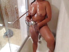 Milf showers and plays on cam