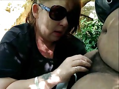 Mature Woman gives blowjob in the woods Preview