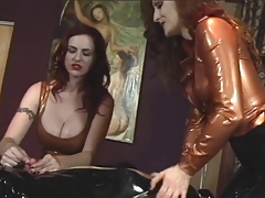 Two brunette freaks play wit a masked guy on the table