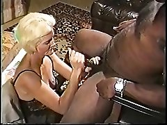Blonde mature granny in lingerie loves sucking on a big hard black dick