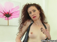 British milf Scarlet fingers her wet cunt