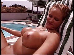 Busty blonde masturbates with huge dildo in the garden