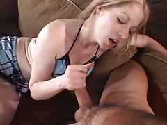 Horny blonde strokes dude's cock against her tits then sits on him to tug away