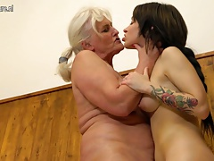 Old granny seducing a young girl in the bathroom
